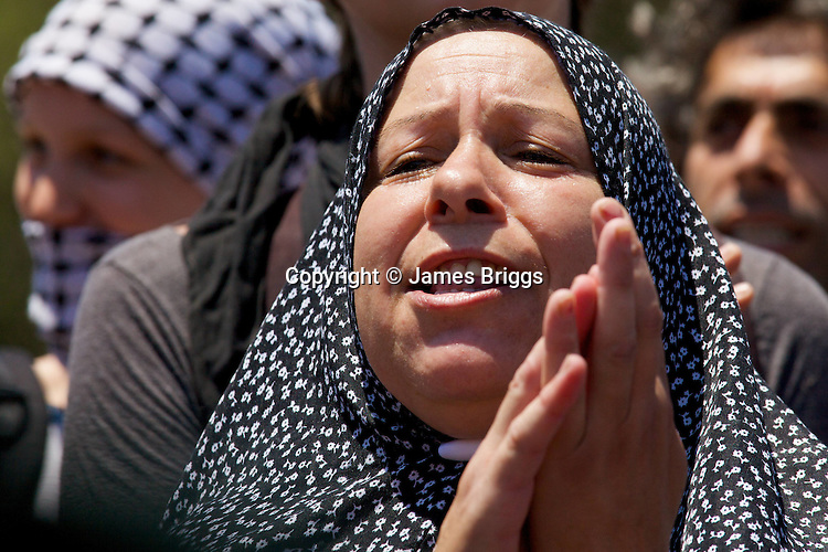 A Palestinian woman protests against the expansion of the nearby Jewish settlement of Halamish, in the West Bank village of Nabi Saleh near Ramallah on 02/07/2010.