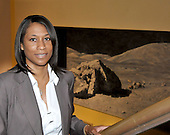 Jeannette Epps, a member of the Astronaut Class of 2009, poses for a photo near a painting in the Alan Bean Exhibit at the National Air and Space Museum in Washington, D.C. on Friday, July 17, 2009.<br /> Credit: Ron Sachs / CNP
