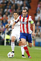 Atletico Madrid´s Uruguayan defense Diego Godin and Real Madrid´s Mexican forward Chicharito