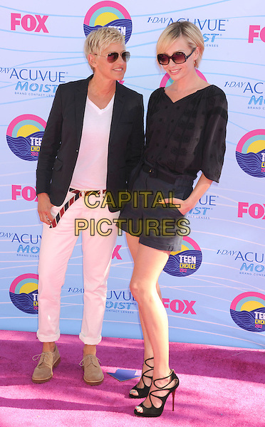 Ellen DeGeneres, Portia de Rossi.FOX's 2012 Teen Choice Awards held at The Gibson Ampitheatre in Universal City, California, USA..July 22nd, 2012.full length blue shorts hands in pockets black top strappy sandals sunglasses shades blazer white cream top belt couple married wife life partners .CAP/ROT/TM.©Tony Michaels/Roth Stock/Capital Pictures