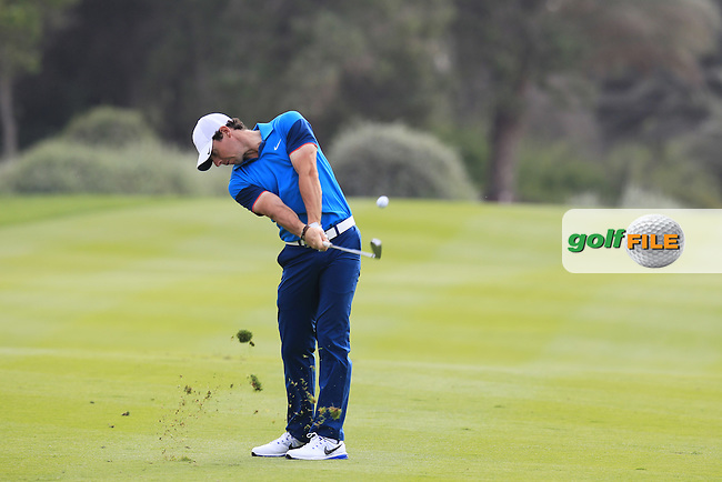 Rory McIlroy (NIR) plays his 2nd shot on the 13th hole during Sunday's Final Round of the Abu Dhabi HSBC Golf Championship 2015 held at the Abu Dhabi Golf Course, United Arab Emirates. 18th January 2015.<br /> Picture: Eoin Clarke www.golffile.ie