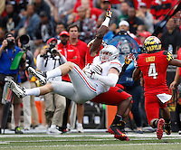 Ohio State Buckeyes tight end Jeff Heuerman (5) catches a pass between Maryland Terrapins linebacker Yannik Cudjoe-Virgil (51) and defensive back William Likely (4) during the third quarter of the NCAA football game at Byrd Stadium in College Park, Maryland on Oct. 4, 2014. (Adam Cairns / The Columbus Dispatch)