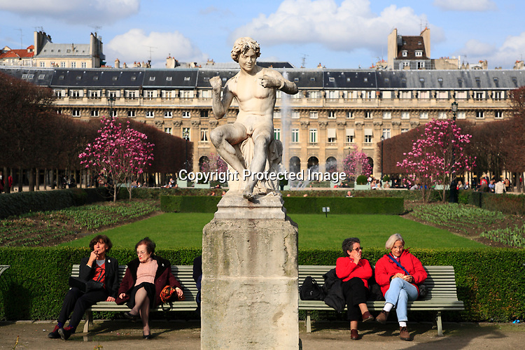 Visitors rest in the garden of Palais Royal. Paris. France