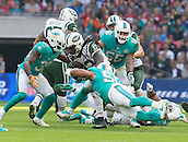 04.10.2015. Wembley Stadium, London, England. NFL International Series. Miami Dolphins versus New York Jets. New York Jets Running Back Chris Ivory pushing his way through the Miami defense.