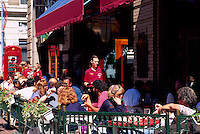 People eating and drinking at an Outdoor Sidewalk Cafe Restaurant in Victoria, Vancouver Island, British Columbia, Canada