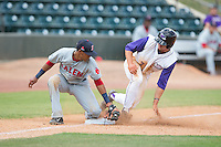 Adam Engel (7) of the Winston-Salem Dash slides into third base ahead of the tag from Deiner Lopez (10) of the Salem Red Sox at BB&T Ballpark on May 31, 2015 in Winston-Salem, North Carolina.  The Red Sox defeated the Dash 6-5.  (Brian Westerholt/Four Seam Images)