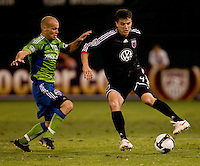Marc Burch, Freddie Ljungberg. The Seattle Sounders defeated DC United, 2-1, to win the 2009 Lamr Hunt U.S. Open Cup at RFK Stadium in Washington, DC.