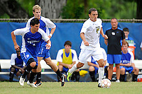 2 October 2011:  FIU midfielder/forward Mario Uribe (17) moves the ball upfield while being pursued by Kentucky defender Charlie Pettys (21) in the first half as the FIU Golden Panthers defeated the University of Kentucky Wildcats, 1-0 in overtime, at University Park Stadium in Miami, Florida.