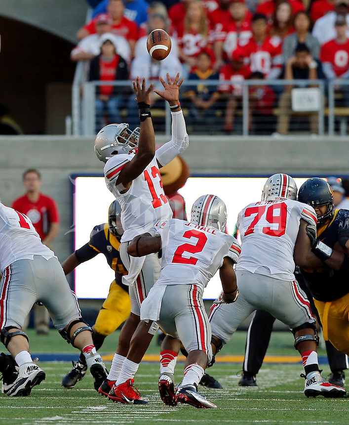 Ohio State Buckeyes quarterback Kenny Guiton (13) grabs a high snap against California Golden Bears in the 3rd quarter at Memorial Stadium in Berkeley, California on September 14, 2013.  (Dispatch photo by Kyle Robertson)