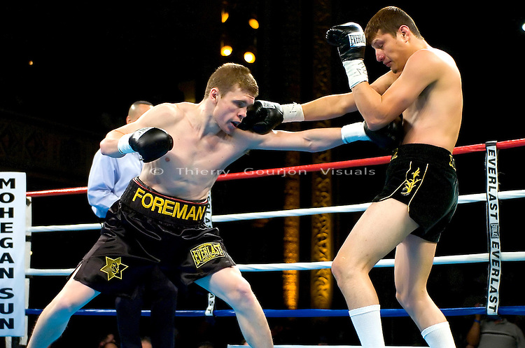 Yuri Foreman (l) connects again Jesus Soto  during their Junior Middleweight 8 rounds fight  at the Hammerstein Ballroom in NYC on 02.24.05. Yuri won the fight by Unanimous Decision.