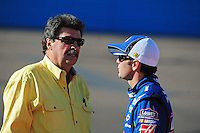 Apr 10, 2008; Avondale, AZ, USA; NASCAR Sprint Cup Series driver Jimmie Johnson (right) talks with Mike Helton during qualifying for the Subway Fresh Fit 500 at Phoenix International Raceway. Mandatory Credit: Mark J. Rebilas-