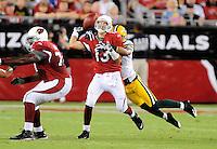 Aug. 28, 2009; Glendale, AZ, USA; Arizona Cardinals quarterback (13) Kurt Warner is sacked by Green Bay Packers cornerback (21) Charles Woodson in the first half during a preseason game at University of Phoenix Stadium. Mandatory Credit: Mark J. Rebilas-