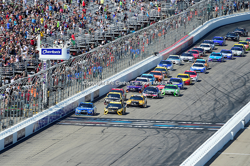 July 16, 2017 - Loudon, New Hampshire, U.S. - Jimmie Johnson, Monster Energy NASCAR Cup Series driver of the Lowe's Chevrolet (48), (left) and Martin Truex Jr, Monster Energy NASCAR Cup Series driver of the Wix Filters Toyota (78), (right) lead the pack at the start of the NASCAR Monster Energy Overton's 301 race held at the New Hampshire Motor Speedway in Loudon, New Hampshire. Larson placed first in the qualifier. Eric Canha/CSM