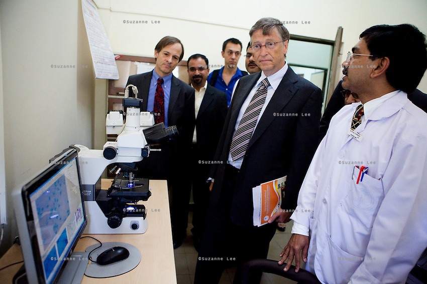Bill Gates (center), co-chairman of the Bill and Melinda Gates Foundation (BMGF), and Peter Small (left), BMGF Deputy Director of TB, enters the microscopy room as doctors give them a tour of the Lala Ram Swawrup (LRS) Institute of Tuberculosis and Respiratory Diseases in New Delhi, India on 24th March 2011, World TB Day.