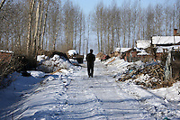 A farmer walks away in Yongfu, on February 28, 2006.  Photo by Lucas Schifres/Pictobank