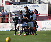 30th September 2017, Dens Park, Dundee, Scotland; Scottish Premier League football, Dundee versus Hearts; Dundee players mob Kerr Waddell after his injury time winner in the 2-1 win over Hearts