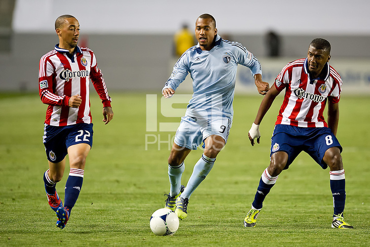 CARSON, CA - April 1, 2012: Ryan Smith (22) and Oswaldo Minda (8) of Chivas and Teal Bunbury (9) of KC during the Chivas USA vs Sporting KC match at the Home Depot Center in Carson, California. Final score Sporting KC 1, Chivas USA 0.