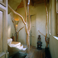 The staircase has been constructed from natural materials including a weathered tree trunk