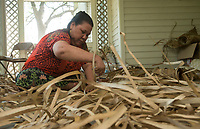 NWA Democrat-Gazette/BEN GOFF @NWABENGOFF Emilie Ned weaves the sail for the KorKor Tuesday, May 8, 2018, at the Shiloh Museum of Ozark History in Springdale. Master canoe builder Liton Beasa and his family, in partnership with the Shiloh Museum of Ozark History, began building the two-man Marshallese canoe called a KorKor April 14 and plan to display the finished canoe at the Little Craft Show Saturday in downtown Springdale.