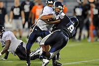 12 August 2011:  FIU's Loranzo Hammonds Jr. (8) attempts to break away from Giovani Fancois (9) during a scrimmage held as part of the FIU 2011 Panther Preview at University Park Stadium in Miami, Florida.
