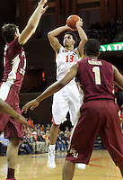 Virginia forward Anthony Gill (13) shoots the ball during an NCAA basketball game Saturday Jan. 18, 2014 in Charlottesville, VA. Virginia defeated Florida State 78-66.
