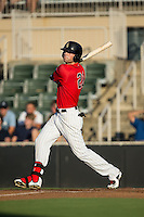 Louie Lechich (21) of the Kannapolis Intimidators follows through on his swing against the Greensboro Grasshoppers at CMC-Northeast Stadium on August 1, 2015 in Kannapolis, North Carolina.  The Intimidators defeated the Grasshoppers 7-4.  (Brian Westerholt/Four Seam Images)