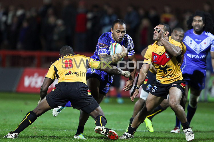 Picture by Alex Whitehead/SWpix.com - 04/11/2013 - Rugby League - Rugby League World Cup - Papua New Guinea v Samoa - Craven Park, Hull, England - Samoa's Mark Taufua is tackled by PNG's Jessie Joe Nandye.