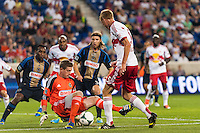 Philadelphia Union goalkeeper Zac MacMath (18) makes a stop on Markus Holgersson (5) of the New York Red Bulls during the first half. The New York Red Bulls and the Philadelphia Union played to a 0-0 tie during a Major League Soccer (MLS) match at Red Bull Arena in Harrison, NJ, on August 17, 2013.