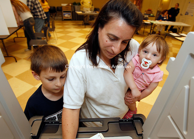 Woodbury, CT-04, May 2010-050410CM09 Roberta Zulpa casts her vote with her children, Jason,7 (left), and Alexandra (14 months) Tuesday evening at the Woodbury Senior Center. Resident's were voting on the 29,723,082 budget for the 2010-2011 fiscal year.   --Christopher Massa Republican-American