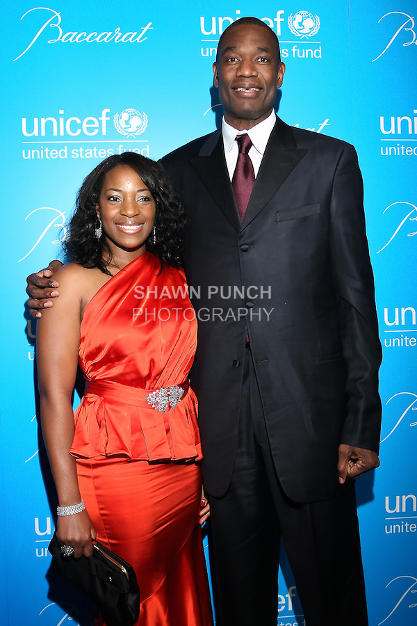 Dikembe Mutombo (r) and Rose Mutombo (l) arrive at the UNICEF Snowflake Ball, Presented by Baccarat, at Cipriani 42nd Street, November 30, 2010.