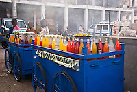 A man is selling colored local drinks from his cart in Port Blair, Andaman Islands, India