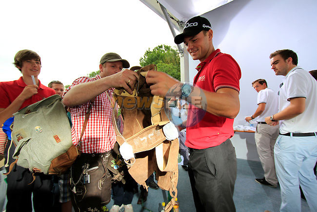 Martin Kaymer (GER) gets a gift of traditional lederhosen after finishing the Pro-Am Day of the BMW International Open at Golf Club Munchen Eichenried, Germany, 22nd June 2011 (Photo Eoin Clarke/www.golffile.ie)