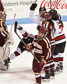 Kelly Wallace (NU - 5), Paige Savage (NU - 28), Brittany Esposito (NU - 7) - The Northeastern University Huskies defeated Boston College Eagles 4-3 to repeat as Beanpot champions on Tuesday, February 12, 2013, at Matthews Arena in Boston, Massachusetts.