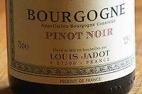 Closeup close-up of a wine bottle label Maison Louis Jadot Bourgogne Pinot Noir Appellation Bourgogne Controlee, Maison Louis Jadot, Beaune Côte Cote d Or Bourgogne Burgundy Burgundian France French Europe European