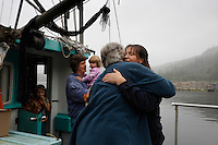 Hugs good bye after a family visit. Lois and Bob Morgan lived on a fishing boat for years, then homesteaded on remote land that had been logged on Kosciusko Island.  They raised their family in a simple, rustic environment. Barbara, their middle daughter, is home for a short time working on a forest service assignment reviewing karst features in a proposed timber sale. Her sister Cindy Wyatt and her family (April, Morgan and husband Eric) arrive for an overnight visit.  They live on nearby Marble Island when they are not fishing for salmon. They have breakfast with neighbors Brad Thomas and his son Christian Smart.