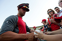 Matt Holliday (7) of the St. Louis Cardinals signs autographs for fans prior to a game against the Springfield Cardinals at Hammons Field on April 2, 2012 in Springfield, Missouri. (David Welker/Four Seam Images)