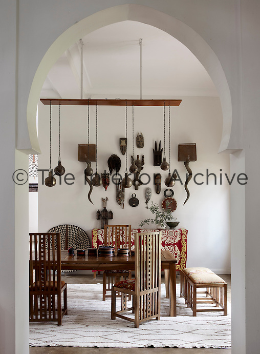 The dining table is surrounded by custom made chairs inspired by Charles Rennie Mackintosh and Frank Lloyd-Wright