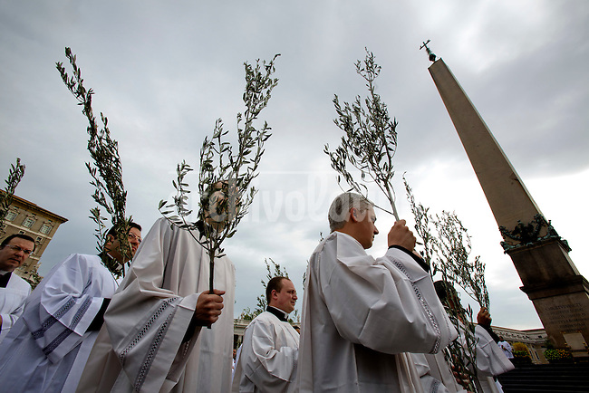 Priest arrive in procession to St Peter Square during the Sunday Palm Mass on April 13, 2014 at Vatican