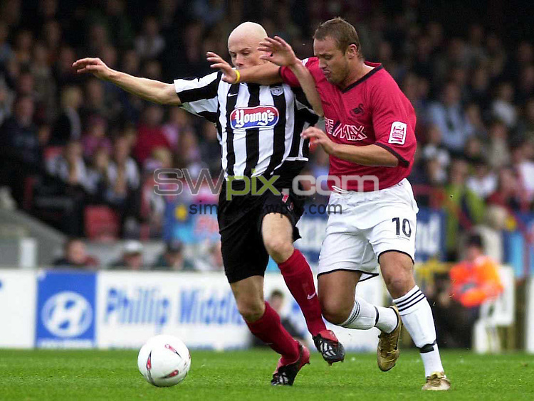 Pix: Chris Whiteoak/SWpix.com. Football. Coca Cola League 2. Grimsby Town v Swansea, 30/10/2004...COPYRIGHT PICTURE>>SIMON WILKINSON>>01943 608782>>..Swansea's Lee Trundle battles with Grimsby's Stacy Coldicott