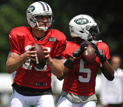 New York Jets quarterbacks Josh McCown #15, left, and Teddy Bridgewater #5 throw passes during team practice at the Atlantic Health Jets Training Center in Florham Park, NJ on Sunday, July 29, 2018.
