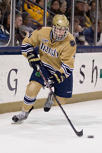 Notre Dame center Riley Sheahan (#4) skates with the puck in first period action of NCAA hockey game between Notre Dame and Boston University.  The Notre Dame Fighting Irish defeated the Boston University Terriers 5-2 in game at the Compton Family Ice Arena in South Bend, Indiana.