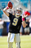 October 02, 2011:  New Orleans Saints quarterback Drew Brees (9) arms up prior to the start of action between the Jacksonville Jaguars and the New Orleans Saints at EverBank Field in Jacksonville, Florida.  New Orleans defeated Jacksonville 23-10.........