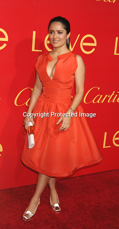 Salma Hayek..arriving at The Cartier and Interview Magazine Party ..for the new Charity Love Bracelet on June 8, 2006 at ..The Cartier Mansion. ..Robin Platzer, Twin Images