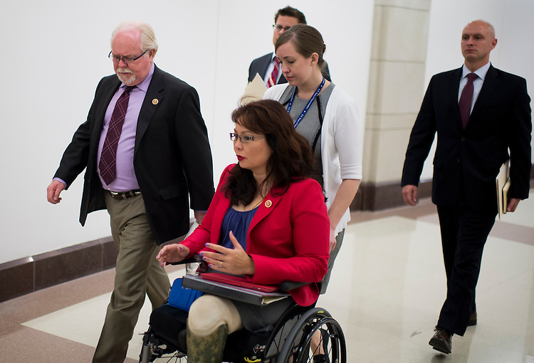 UNITED STATES - SEPTEMBER 9: Rep. Ron Barber, D-Ariz., left, and Rep. Tammy Duckworth, D-Ill., right, talk as they arrive for the House Armed Services Committee and House (Select) Intelligence Committee joint closed briefing on Syria in the Capitol Visitor Center on Monday, Sept. 9, 2013. (Photo By Bill Clark/CQ Roll Call)