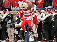 Brutus Buckeye celebrates near the Ohio State University marching band during the second half of Saturday's NCAA Division I football game against the Michigan Wolverines at Michigan Stadium in Ann Arbor on November 25, 2017.  Ohio State won the game 31-20. [Barbara J. Perenic/Dispatch]