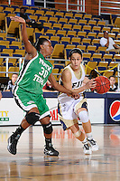 6 February 2010:  FIU's Michelle Gonzalez (5) drives to the basket wile being defended by North Texas' Brittney James (30) in the second half as the FIU Golden Panthers defeated the North Texas Mean Green, 72-55, at the U.S. Century Bank Arena in Miami, Florida.