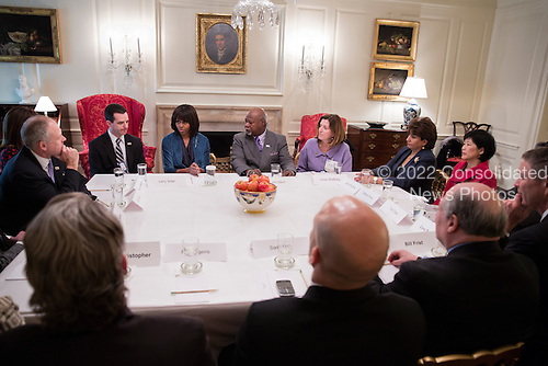 First Lady Michelle Obama drops by a Partnership for a Healthier America board meeting in the Map Room of the White House, March 6, 2013. .Mandatory Credit: Lawrence Jackson - White House via CNP
