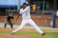 Asheville Tourists starting pitcher Johendi Jiminian #31 delivers a pitch during a game against the Lexington Legends at McCormick Field on May 14, 2014 in Asheville, North Carolina. The Legends defeated the Tourists 11-2. (Tony Farlow/Four Seam Images)