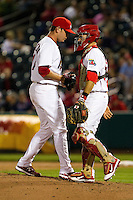 Nick Additon (11) of the Springfield Cardinals talks with catcher Nick Derba (31) during a game against the Frisco RoughRiders on April 14, 2011 at Hammons Field in Springfield, Missouri.  Photo By David Welker/Four Seam Images.