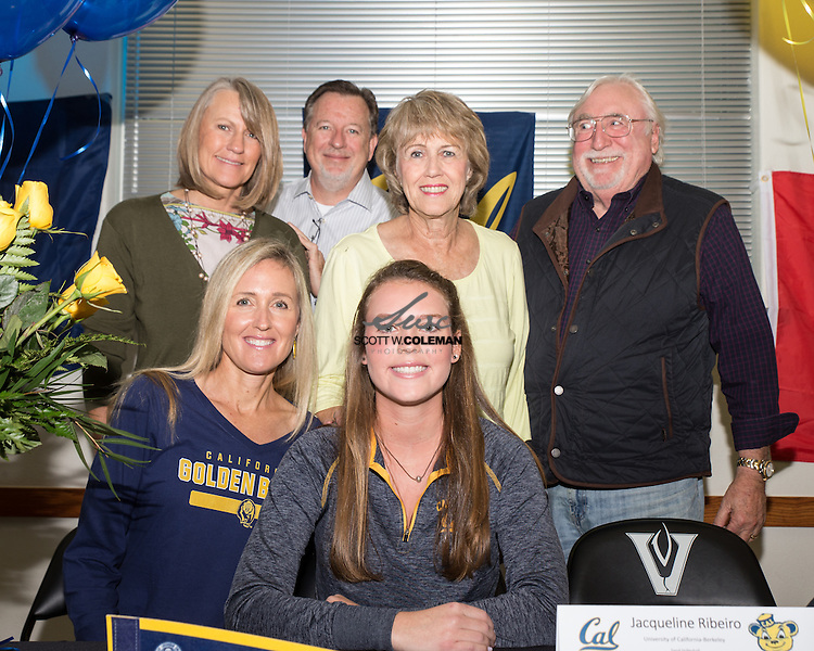 Jacqueline Ribiero and family celebrate signing to play sand volleyball at the University of California in a signging day ceremony at Vandegrift High School in Austin, Texas, on November 10, 2016.